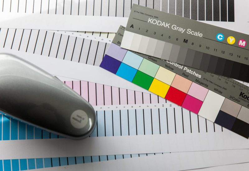 black and gray remote control on white ruled paper